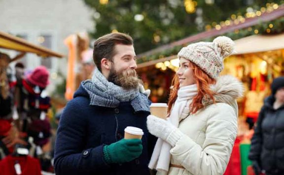 A couple enjoy the Kingston Christmas market