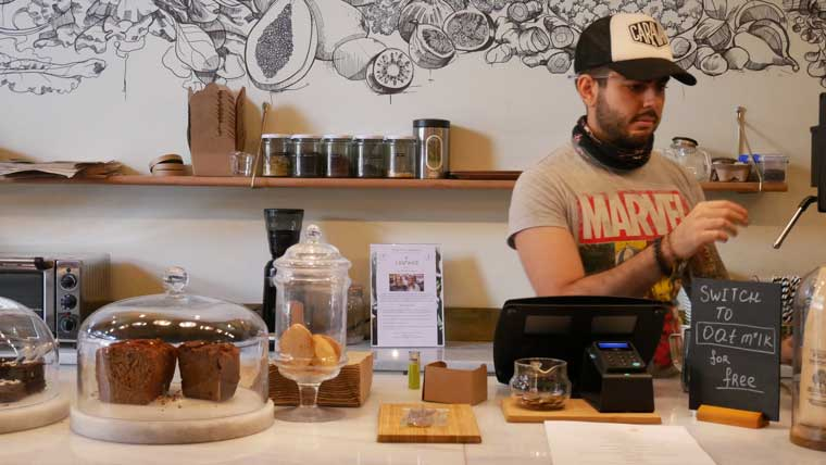 A waiter serving London's best gluten free foods at the Leafwild Cafe