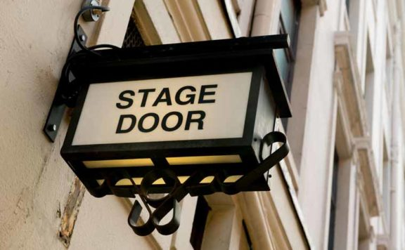 A sign for the stage door at West End Theatre production Les Miserables