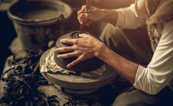 A Craftsman making pottery from wet clay for the London Craft Week