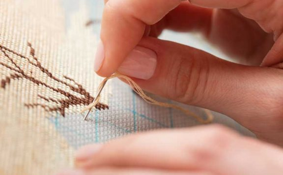 A Craftsperson doing embroidery