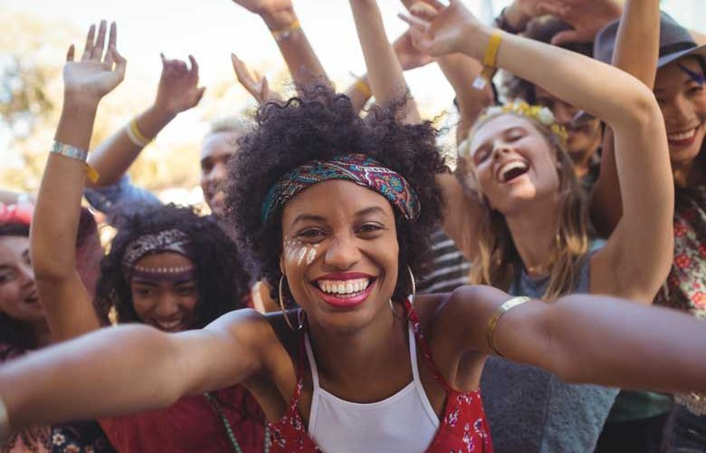 A crowd dance at the Notting Hill Carnival - one of our things to do in London in August 2019